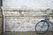 Ladies Bike Photos - Bike against church wall by Guido Koppes