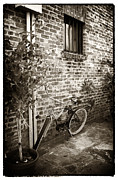 Bike In Pirates Alley Print by John Rizzuto