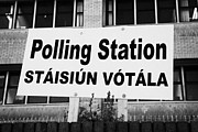 Poll Acrylic Prints - Bilingual Irish Polling Station Sign Dublin Republic Of Ireland Acrylic Print by Joe Fox
