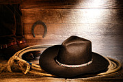 Ranch Framed Prints - Black Felt Cowboy Hat Framed Print by Olivier Le Queinec