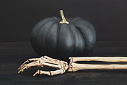Sandra Cunningham - Black pumpkin with skeleton arm and hand