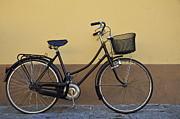 Black Woman Bicycle On Wall Print by Sami Sarkis