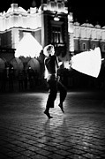 Dancer Art Posters - Blonde Female Fire Dancer Street Entertainer Dances With Fire In Front Of The Cloth Hall In Krakow Poster by Joe Fox