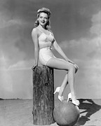 Two Piece Photos - Blonde On A Piling by Underwood Archives