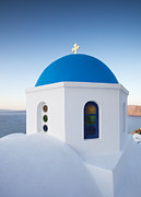 Greek Icon Photo Posters - Blue domed church in Oia Santorini Greece Poster by Matteo Colombo