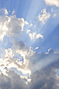 Sun Sky Clouds Posters - Blue sky with sun rays Poster by Elena Elisseeva