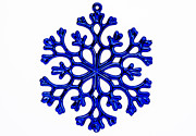 Holidays And Celebrations Prints - Blue snowflake ornament isolated on a white background. Print by Dawna  Moore Photography