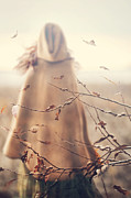 Sandra Cunningham - Blurred image of a woman with cape