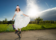 Elegant Bride Posters - BMX Flatland bride in white wedding dress Poster by Matthias Hauser