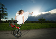 Bride Posters - BMX Flatland rider Monika Hinz jumps in Wedding Dress Poster by Matthias Hauser