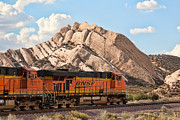 Locomotives Photos - BNSF past Mormon Rocks by Peter Tellone