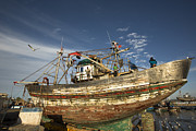 Moroccan Photos - Boat being repaired in Essaouira harbour by Ruben Vicente