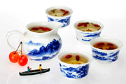 Blue And White Porcelain Prints - Boating among china tea cups little people on food Print by Paul Ge