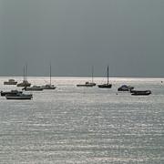 Boats In The Sea. Normandy. France. Europe Print by Bernard Jaubert