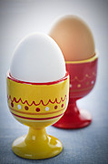 Eggs Photos - Boiled eggs in cups by Elena Elisseeva