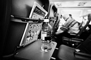 Bottled Photo Prints - Bottle Of Water On Tray Table Interior Of Jet2 Aircraft Passenger Cabin In Flight Europe Print by Joe Fox