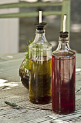 Balsamic Vinegar Photo Posters - Bottles of olive oil and vinegard at table Poster by Strahil Dimitrov