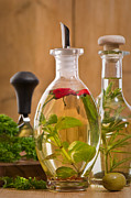 Herbs Prints - Bottles Of Olive Oil Print by Christopher Elwell and Amanda Haselock