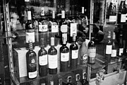 Wines Photos - Bottles Of Spanish Wine On Window Display In A Store In Barcelona Catalonia Spain by Joe Fox
