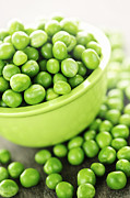 Seeds Prints - Bowl of green peas Print by Elena Elisseeva