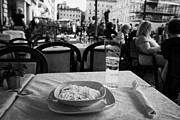 Dining Table Posters - Bowl of Spagetti Carbonara and glass of beer sitting on a table in a street cafe in the Piazza Navona Rome Lazio Italy Poster by Joe Fox