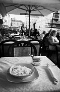 Spaghetti Prints - Bowl of Spagetti Carbonara and small bowl of parmesan cheese sitting on a table in a street cafe in the Piazza Navona Rome Lazio Italy Print by Joe Fox