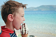 Snacking Posters - Boy eating ice cream Poster by Tom Gowanlock
