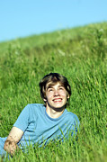 Boy Art - Boy lying on the fresh green grass by Michal Bednarek