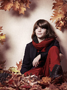 Dreamy Expression Posters - Boy sitting on autumn leaves artistic portrait Poster by Oleksiy Maksymenko