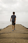 Boy Walking On Concrete Beach Pier Print by Edward Fielding