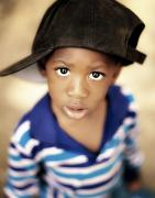 African-americans Photo Framed Prints - Boy Wearing Over Sized Hat Sideways Framed Print by Ron Nickel