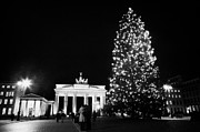 Berlin Germany Framed Prints - Brandenburg gate and christmas tree in pariser platz with tourists at night Berlin Germany Framed Print by Joe Fox