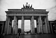 Berlin Germany Prints - Brandenburg gate on a wet winter day Berlin Germany Print by Joe Fox