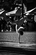 Polish Culture Framed Prints - Breakdancing Male Young Street Entertainer Does A Hand Stand In The Rynek Glowny Main Square In The Old Town Krakow Framed Print by Joe Fox