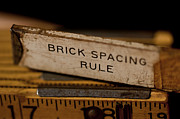 Grime Photo Prints - Brick Masons Rule Print by Wilma  Birdwell