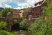 Alsace Framed Prints - Bridge over a stream through the village of Kaysersberg Framed Print by Jan Marijs