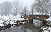 Gapstow Bridge Framed Prints - Bridge Over River In A Snowstorm Framed Print by Fizzy Image