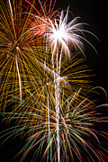 Pyrotechnic Photos - Bright bursts of fireworks by Garry Gay