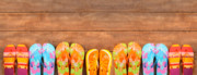 Pink Shoes Prints - Brightly colored flip-flops on wood  Print by Sandra Cunningham