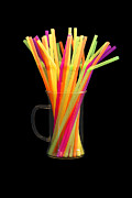 Coffee Drinking Prints - Brightly colored straws isolated on black Print by Greg Elk