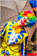Perform Art - Brightly dressed clown with umbrella by David Hill
