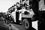 Unrest Framed Prints - British army armoured Saxon personnel carrier vehicle on crumlin road at ardoyne shops belfast 12th  Framed Print by Joe Fox