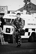 Violent Prints - British Army soldier at PSNI landrover on crumlin road at ardoyne shops belfast 12th July Print by Joe Fox