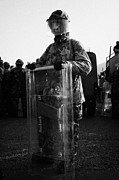 Unrest Framed Prints - British Army soldier in riot gear stands guard on crumlin road at ardoyne shops belfast 12th July Framed Print by Joe Fox