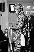 Unrest Framed Prints - British Army soldier in riot gear with fire extinguisher in front of land rover on crumlin road at a Framed Print by Joe Fox