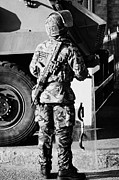 Unrest Framed Prints - British army soldier in riot gear with SA80 in front of Saxon vehicle on crumlin road at ardoyne sho Framed Print by Joe Fox