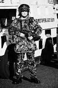British Army Soldier With Mp5 On Crumlin Road At Ardoyne Shops Belfast 12th July Print by Joe Fox