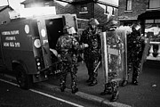 Unrest Framed Prints - British Army soldiers in riot gear pack up on crumlin road at ardoyne shops belfast 12th July Framed Print by Joe Fox
