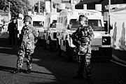 Unrest Framed Prints - British army soldiers with PSNI landrovers on crumlin road at ardoyne shops belfast 12th July Framed Print by Joe Fox