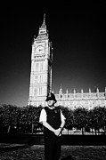 Bobby Hat Framed Prints - british metropolitan police office guarding the houses of parliament London England UK Framed Print by Joe Fox
